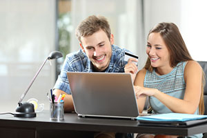 Couple with laptop at desk